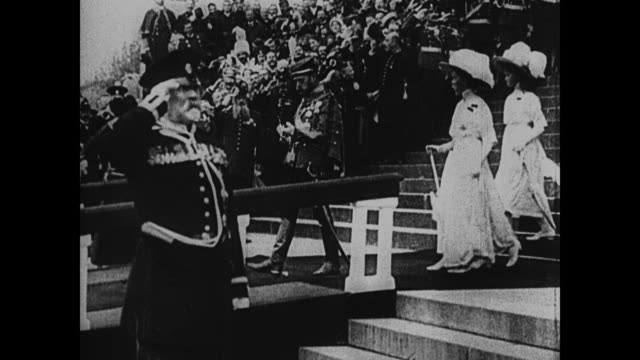 RUSSIA Czar Nicolas II walking down steps dressed full military uniform followed by three of his daughters entering open carriage military men line...