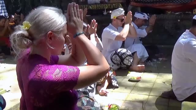 a czech couple slammed for disrespecting a balinese temple takes part in a ritual purification ceremony after their antics sparked warnings that... - hinduism stock videos & royalty-free footage