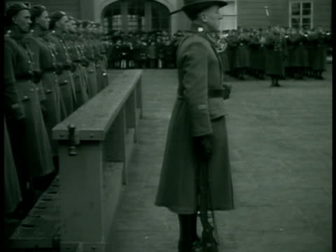 CZECHOSLOVAKIA Czech soldiers standing at attention in square military band playing BG President of Czechoslovakia Edvard Benes talking w/ military...