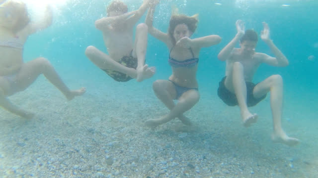 dab pose underwater - girl cross legged stock videos & royalty-free footage
