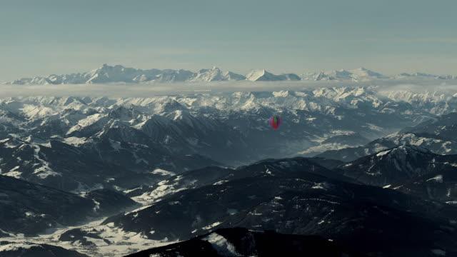 aerial ws pan dachstein mountains / austria - dachstein mountains stock videos and b-roll footage