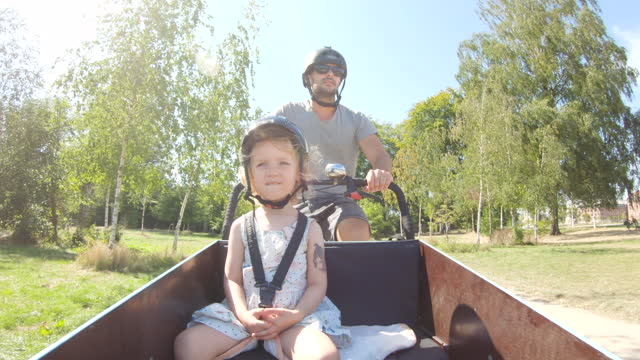 dad and daughter on cargo bike - tricycle stock videos & royalty-free footage
