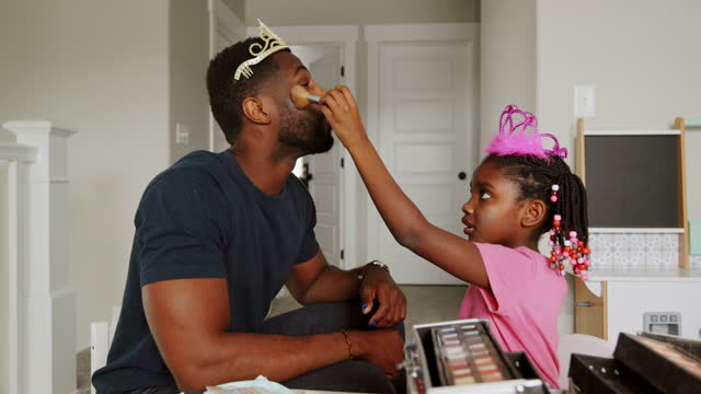 dad and daughter playtime dress-up and putting on makeup - males stock videos & royalty-free footage