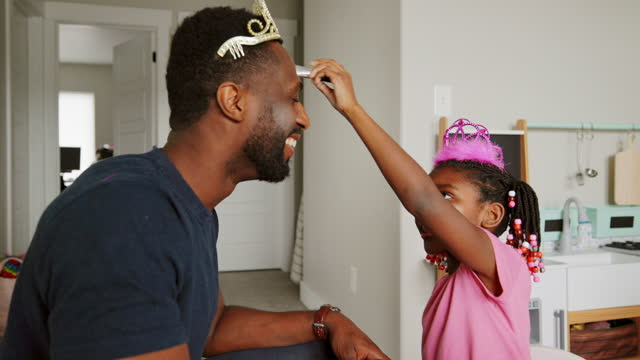 dad and daughter playtime dress-up and putting on makeup - daughter stock videos & royalty-free footage