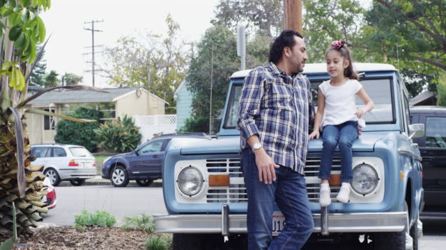 dad and daughter standing outside in front of their vintage car - latin american and hispanic ethnicity stock videos & royalty-free footage