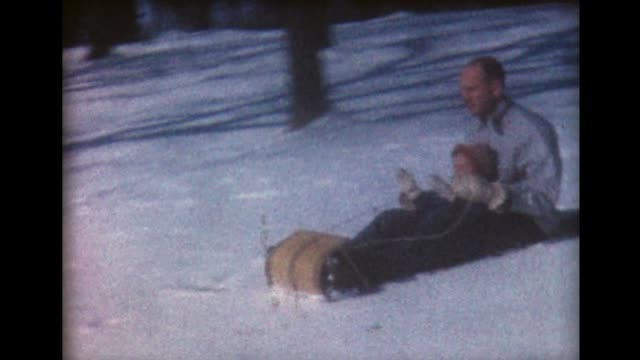 1960 dad and girl on toboggan - winter sport stock videos and b-roll footage