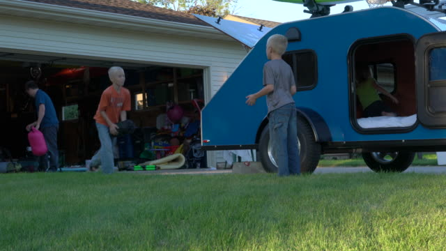 dad and kids load bags into mini camper, ws - camper trailer stock videos and b-roll footage