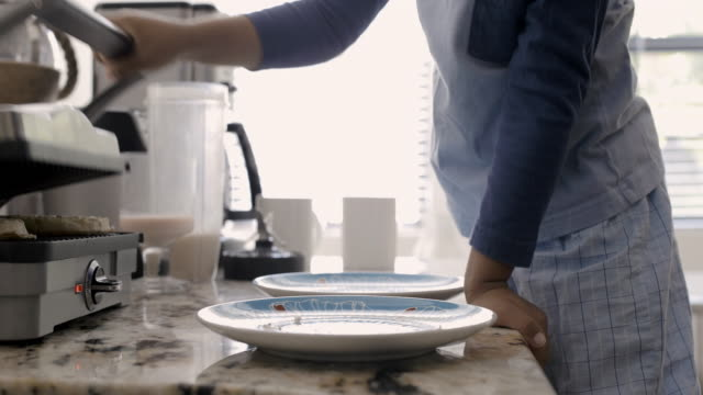 vidéos et rushes de ms dad and son (5-6) make breakfast together - waffles