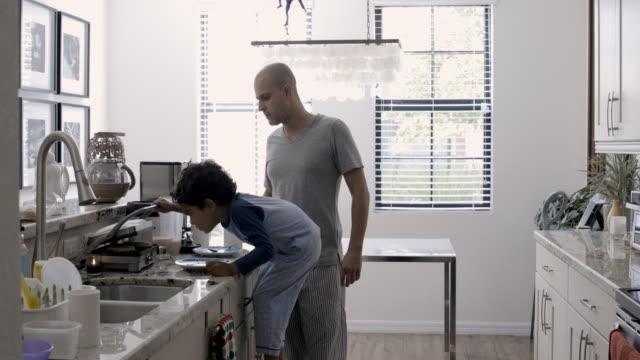 vídeos y material grabado en eventos de stock de ws dad and son (5-6) making waffles for breakfast - waffles