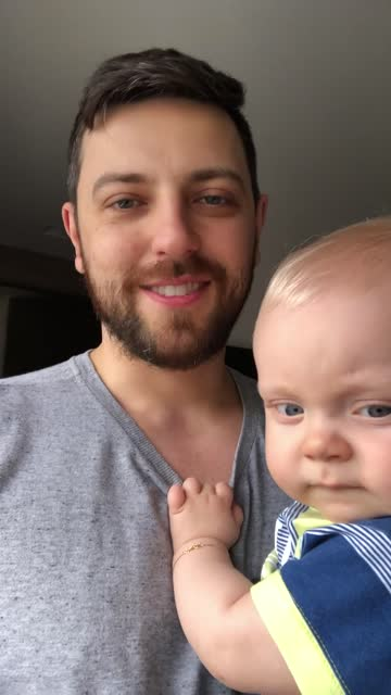 dad and son on a video call at home - waving stock videos & royalty-free footage