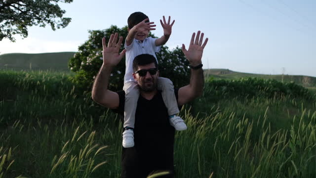 dad and son outdoors - family with one child stock videos & royalty-free footage