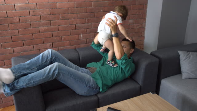 dad and son time at home - genderblend stock videos & royalty-free footage