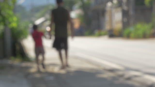 dad and son walking - genderblend stock videos & royalty-free footage