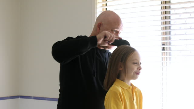 dad brushing daughter's hair - brushing stock videos & royalty-free footage