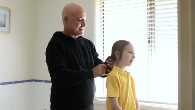 dad brushing daughter's hair - back to school stock videos & royalty-free footage