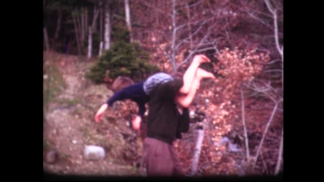 1965 dad carries daughter with dirty feet over his shoulder - unfug stock-videos und b-roll-filmmaterial