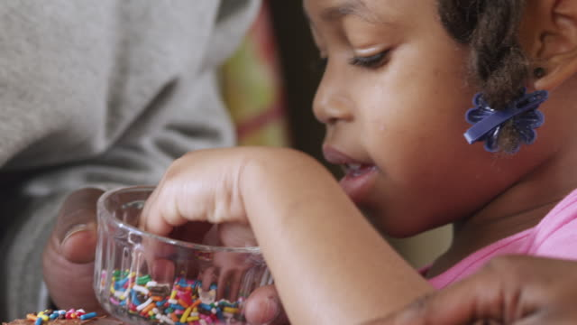 cu pan dad daughter and son frosting and sprinkling cupcake / dallas, texas, usa - sprinkles stock videos and b-roll footage