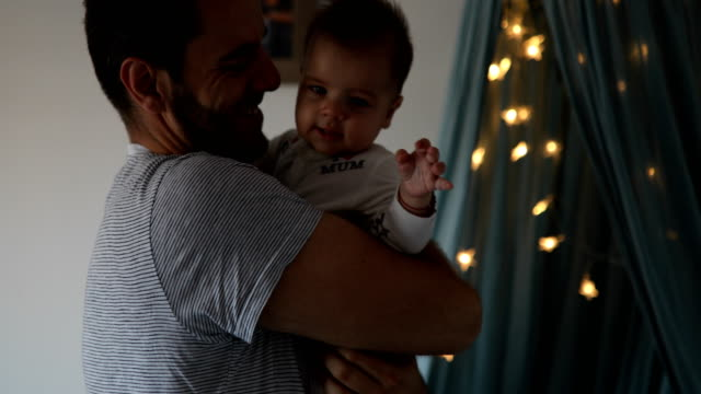 dad embracing and kissing baby - single father stock videos & royalty-free footage