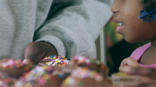 CU PAN TU Dad frosting cupcakes while kids watching / Dallas, Texas, USA