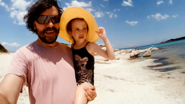 dad having fun with his daughter at a beach - tourist resort stock videos and b-roll footage
