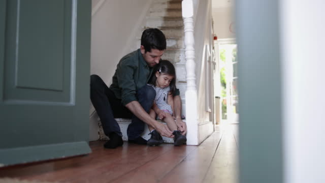 dad helping daughter with her shoes - baby girls stock videos & royalty-free footage