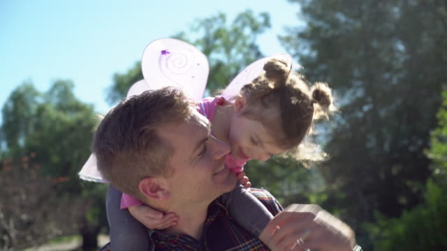 cu dad holding his daughter on his shoulders. - daughter stock videos & royalty-free footage