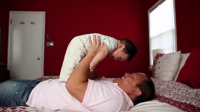ms dad play with baby / los angeles, ca, united states - genderblend stock videos & royalty-free footage