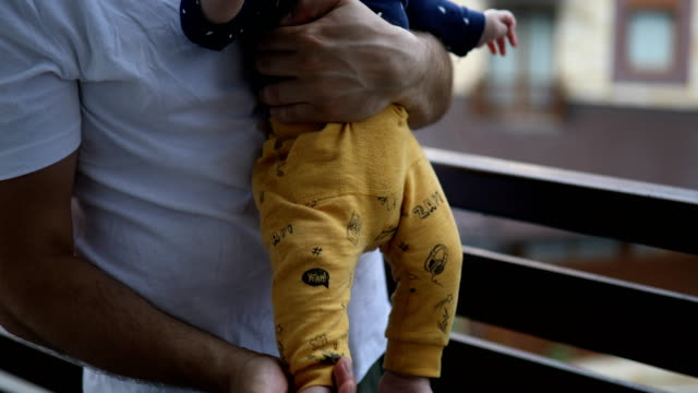 dad playing with baby on the balcony - balcony stock videos & royalty-free footage