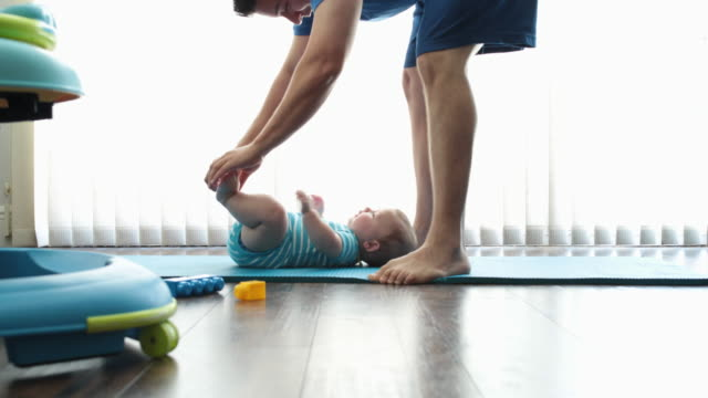 dad playing with baby son on floor at home - tickling stock videos & royalty-free footage