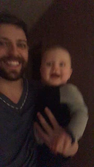 vídeos de stock e filmes b-roll de dad running with his son at home filmed by mobile phone - imagem em movimento