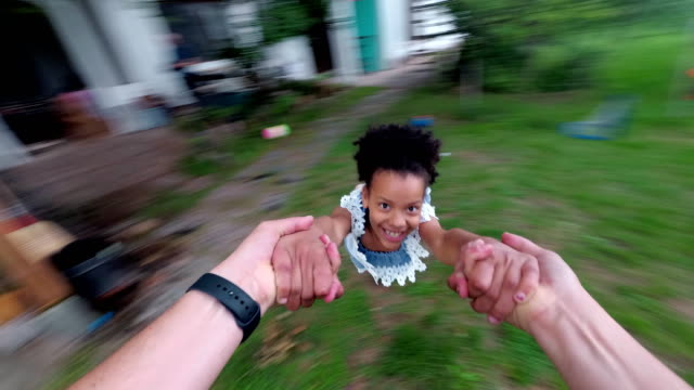 dad spinning little girl in air - personal perspective stock videos & royalty-free footage