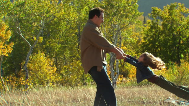 dad swinging daughter around - see other clips from this shoot 1165 stock videos and b-roll footage