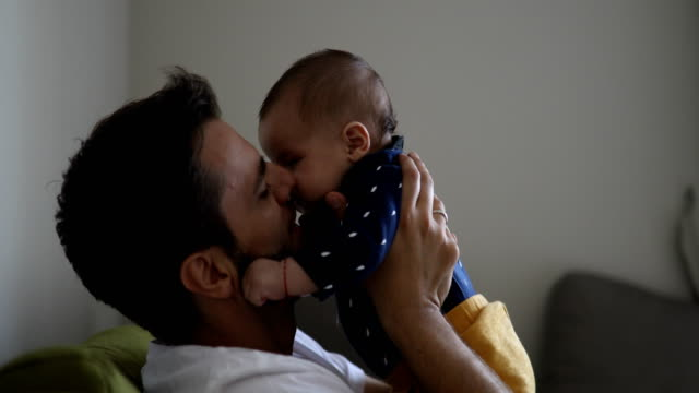 dad tossing baby in the air - kissing stock videos & royalty-free footage