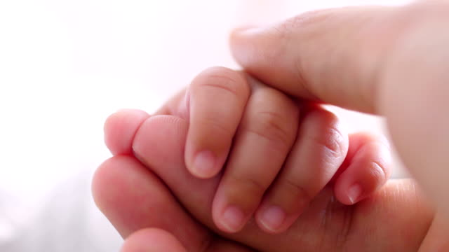 dad touching baby hand - fingernail stock videos & royalty-free footage