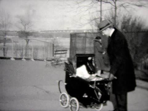 1931 dad walks baby in old carriage - 1931 stock videos & royalty-free footage