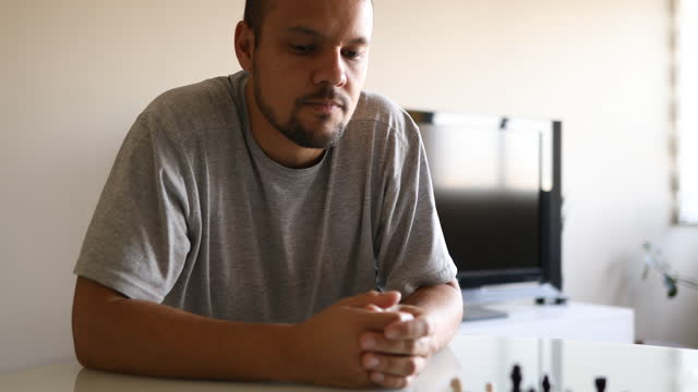 dad watching his daughter's move in chess game - dia stock videos & royalty-free footage