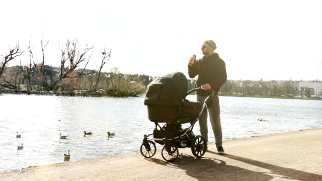 dad with coffee and pram - scandinavian culture stock videos and b-roll footage