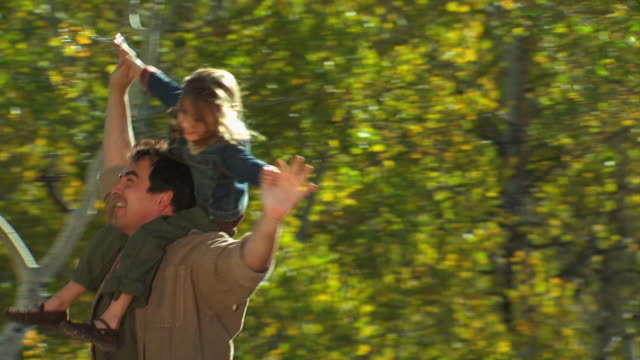 dad with daughter on his shoulders - see other clips from this shoot 1165 stock videos and b-roll footage