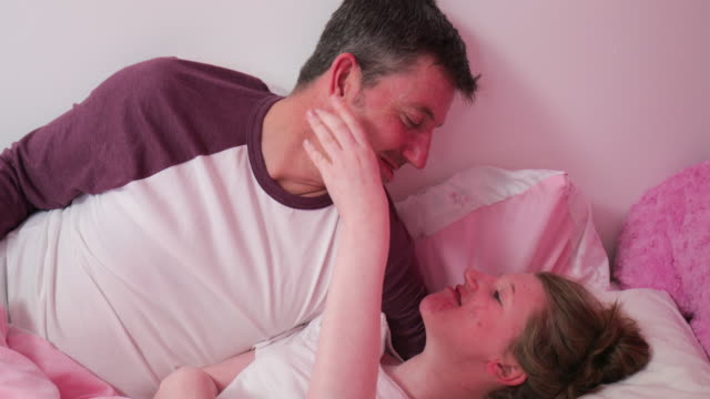 Dad with Disabled Daughter in Bed