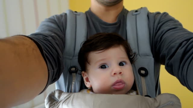 daddy and baby - baby carrier stock videos & royalty-free footage