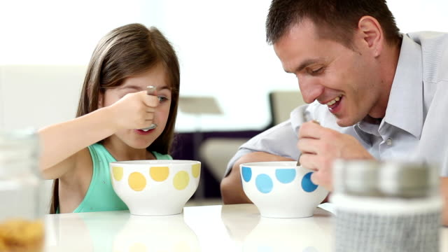 daddy and daughter having breakfast - cereal plant stock videos & royalty-free footage