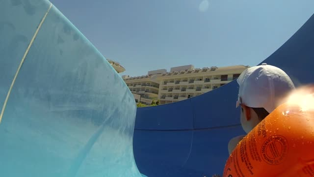 Daddy And Son Slow Motion Water Slide Shot
