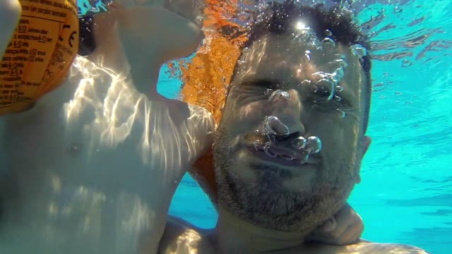 Daddy And Son under the Water