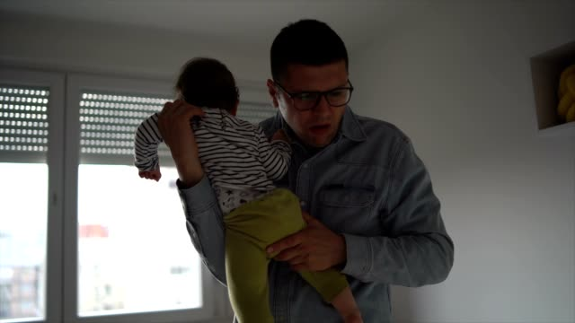daddy is taking care of the baby - changing nappy stock videos & royalty-free footage