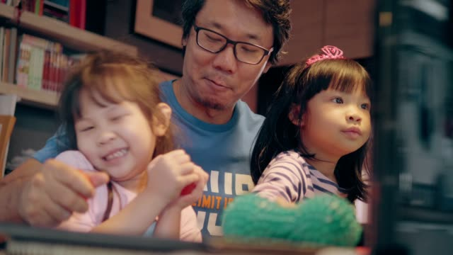 daddy is teaching his children-stock video - east asian ethnicity stock videos & royalty-free footage