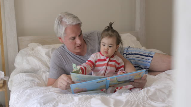 daddy reading a story - man made stock videos & royalty-free footage