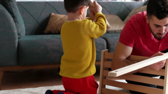 daddy's little helper - manual worker stock videos & royalty-free footage