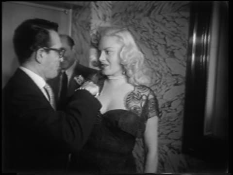 dagmar being interviewed at meet danny wilson premiere / newsreel - 1951年点の映像素材/bロール