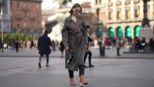 dagmara jarzynka wears blule sunglasses, a gray oversized long coat with checked inner lining, a white top, a black shiny bag, pale brown leather... - checked pattern stock videos & royalty-free footage