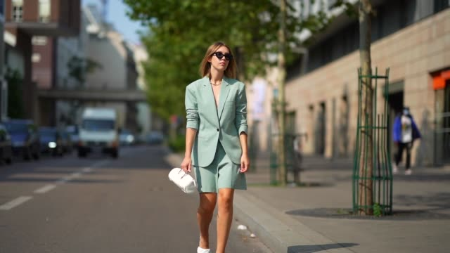 dagmara jarzynka wears sunglasses, a pale green oversized blazer jacket/suit from designers remix, shorts, a white leather cylinder-shaped long bag,... - green colour stock videos & royalty-free footage
